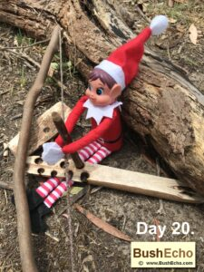 Elf on the Shelf is making friction fire.